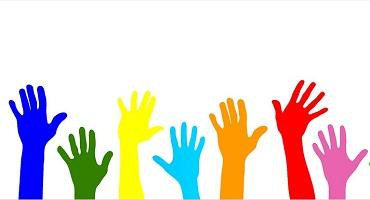 A graphic showing raised hands in a variety of bright colours