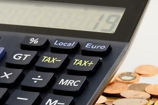 A close up shot of a calculator with tax function buttons