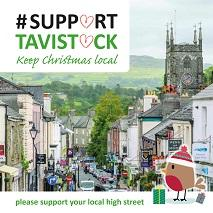 A photograph of Tavistock High Street with Christmas decorations and the message 'Support Tavistock'